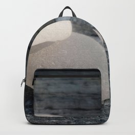 Two White Sea Glass Pieces on Grey Wood Backpack