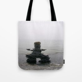 Stone Inukshuk on The Shore Looking Out Over Calm Water ~ A Meaningful Messenger Tote Bag