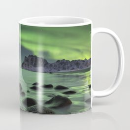 Aurora borealis over a beach on the Lofoten in Norway Coffee Mug