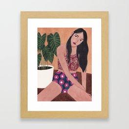 Sitting on the floor Framed Art Print