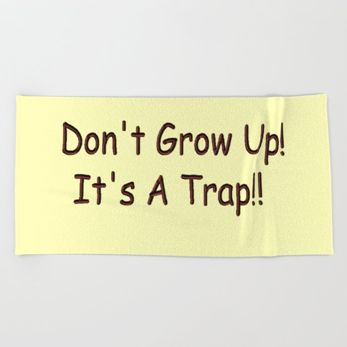 Don't Grow Up!  It's A Trap!! Beach Towel