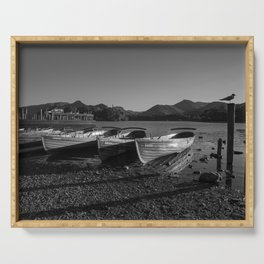 a black and white image of rowing boats moored at derwentwater Serving Tray