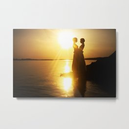 Silhouette couple kissing over sunset background Metal Print