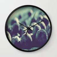 indigo Wall Clocks featuring Indigo by Nieves Montano