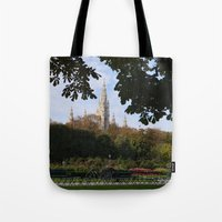 vienna Tote Bags featuring vienna volksgarten by Lisa Carpenter