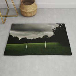 Football goalposts in an empty field Rug