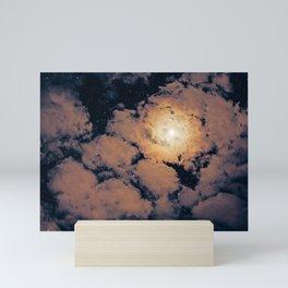 Full moon through purple clouds Mini Art Print