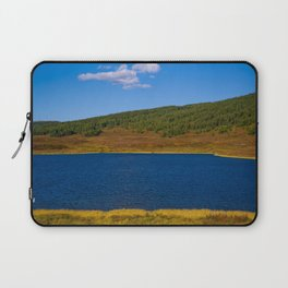 Calm water pond with greenery on mountain in background Laptop Sleeve
