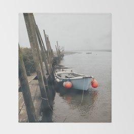 Boats moored at Blakeney in fog. Norfolk, UK. Throw Blanket