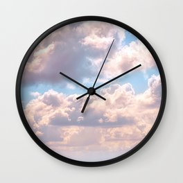 Illuminated fluffy clouds in a blue sky Wall Clock