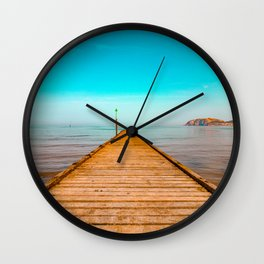 beautiful blue sky and  the wooden jetty at the beach Wall Clock
