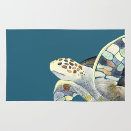 Watercolor sea turtle with teal background Rug