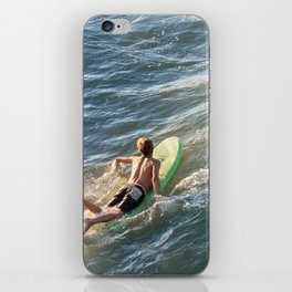 Surfer paddles out on surfboard without a wetsuit iPhone Skin