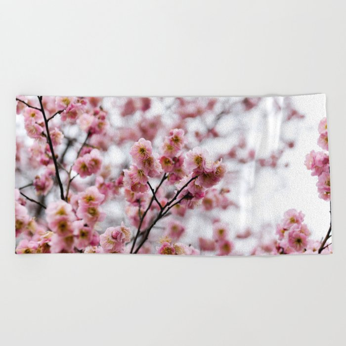 The First Bloom Beach Towel