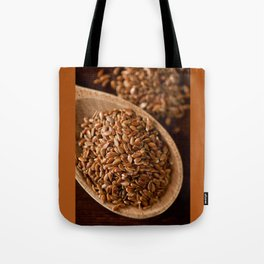 Brown flax seeds portion on wooden spoon Tote Bag