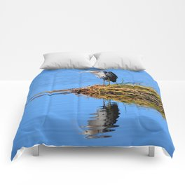 blue heron reflection Comforters