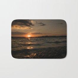 Sunset above the lake Bath Mat