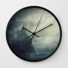 on the top of a cliff Wall Clock