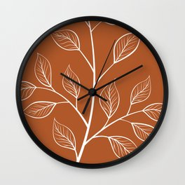 Delicate White Leaves and Branch on a Rust Orange Background Wall Clock