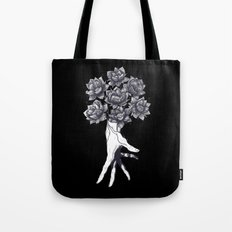 Hand with lotuses on black Tote Bag
