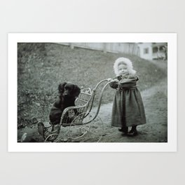 Child pushing her pet dog in a baby carriage Art Print