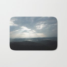 Clouds with Sun Shining on the Mountains Bath Mat