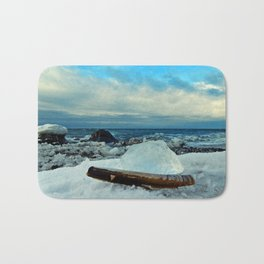 Spring Comes to the Beach in Ice that glows Blue Bath Mat