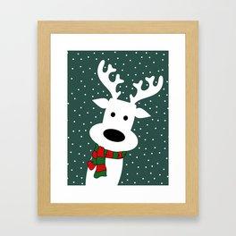 Reindeer in a snowy day (green) Framed Art Print