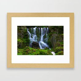 Waterfall in the mountain park Framed Art Print