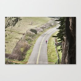 The lonely cyclist Canvas Print