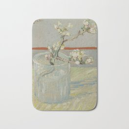 Sprig of Flowering Almond in a Glass Bath Mat