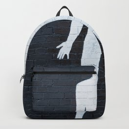 mural depicting a man painted in white with a red heart Backpack