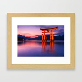 Wonderful sunset colors at the famous floating Torii Gate on Miyagima Island, Japan. Framed Art Print