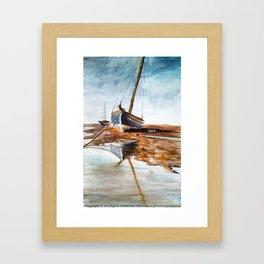 silent beached sailboat Framed Art Print
