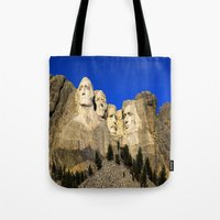 rushmore Tote Bags featuring Mount Rushmore  by Brett Knight