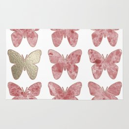 Golden rosy mauve butterflies Rug