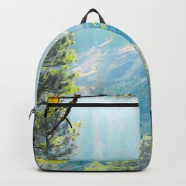 green pine tree with mountains background at Lake Tahoe, California, USA Backpack