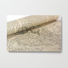 Old glasses and map. Metal Print