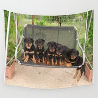 puppies Wall Tapestries featuring Six Rottweiler Puppies Lined Up On A Swing by taiche