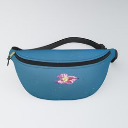 A pink blossom floating in a contrast blue lake Fanny Pack