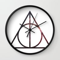 deathly hallows Wall Clocks featuring Deathly Hallows by Michal