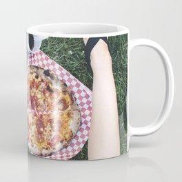 Woman eating salami pizza on the grass Coffee Mug