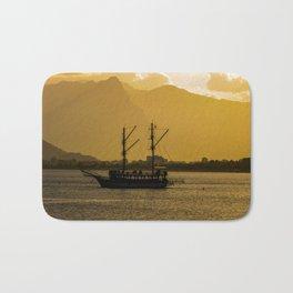 Ship in sunset Bath Mat