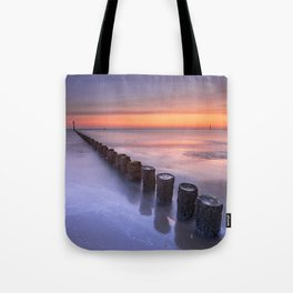 Breakwater on the beach at sunset in Zeeland, The Netherlands Tote Bag