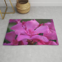 Pink Oleander Flower With Green Leaves in the Background Rug
