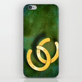 Lucky horseshoes on a textured green background iPhone Skin
