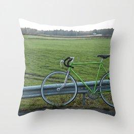 Bike on a Field Throw Pillow