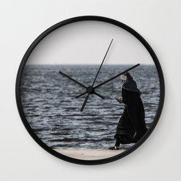 Young muslim girl walking at seaside Wall Clock