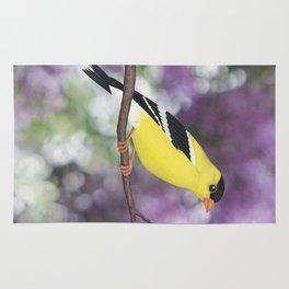 American goldfinch male bokeh Rug