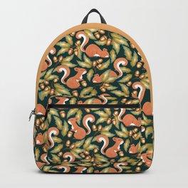 Acorns, Oak Leaves, and Happy Red Squirrels - on dark leafy green Backpack